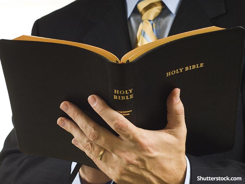 christianmanholdingbiblejpg