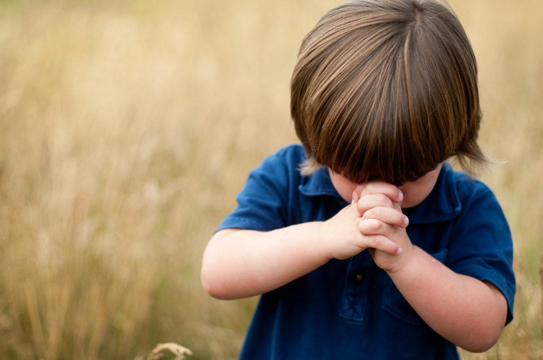 Little boy praying.